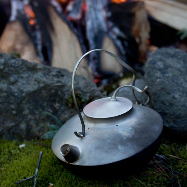 Silverkanna, eld, skog.