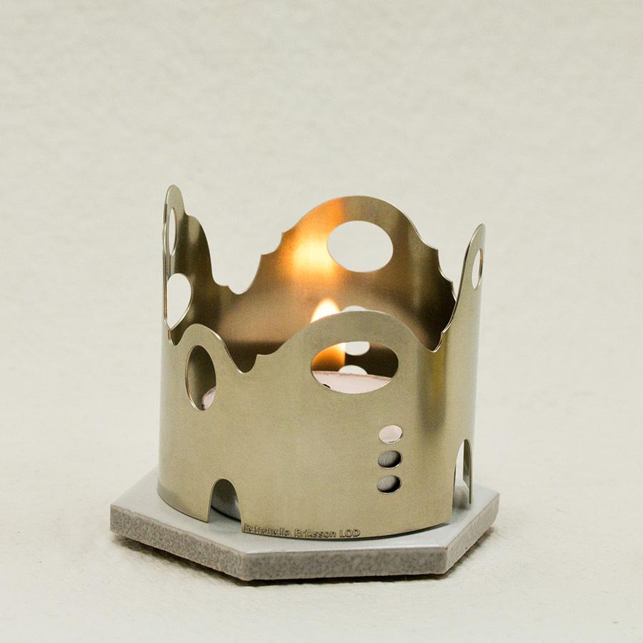 Ljuslycktor i form av hus eller ett runt kvarter i mässing brons och nysilver.